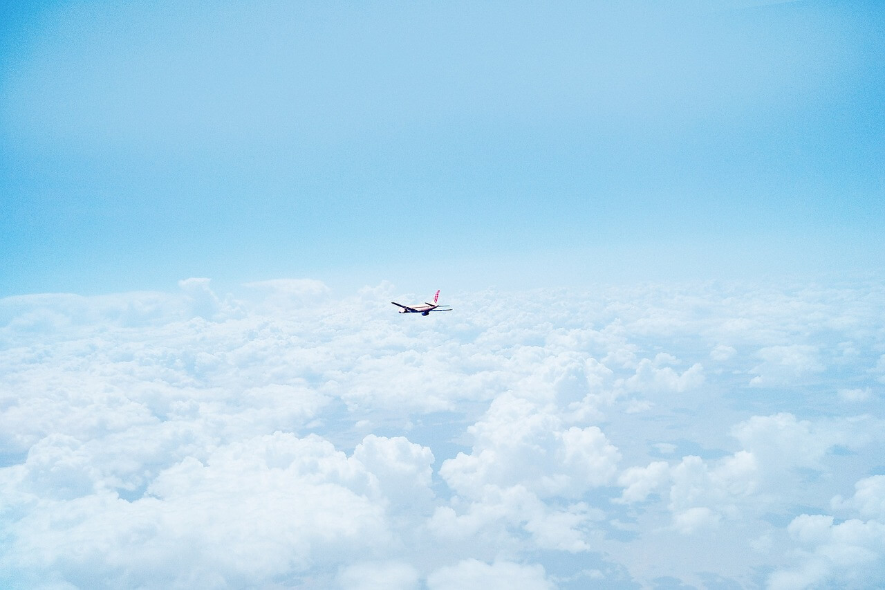 airplane-above-clouds