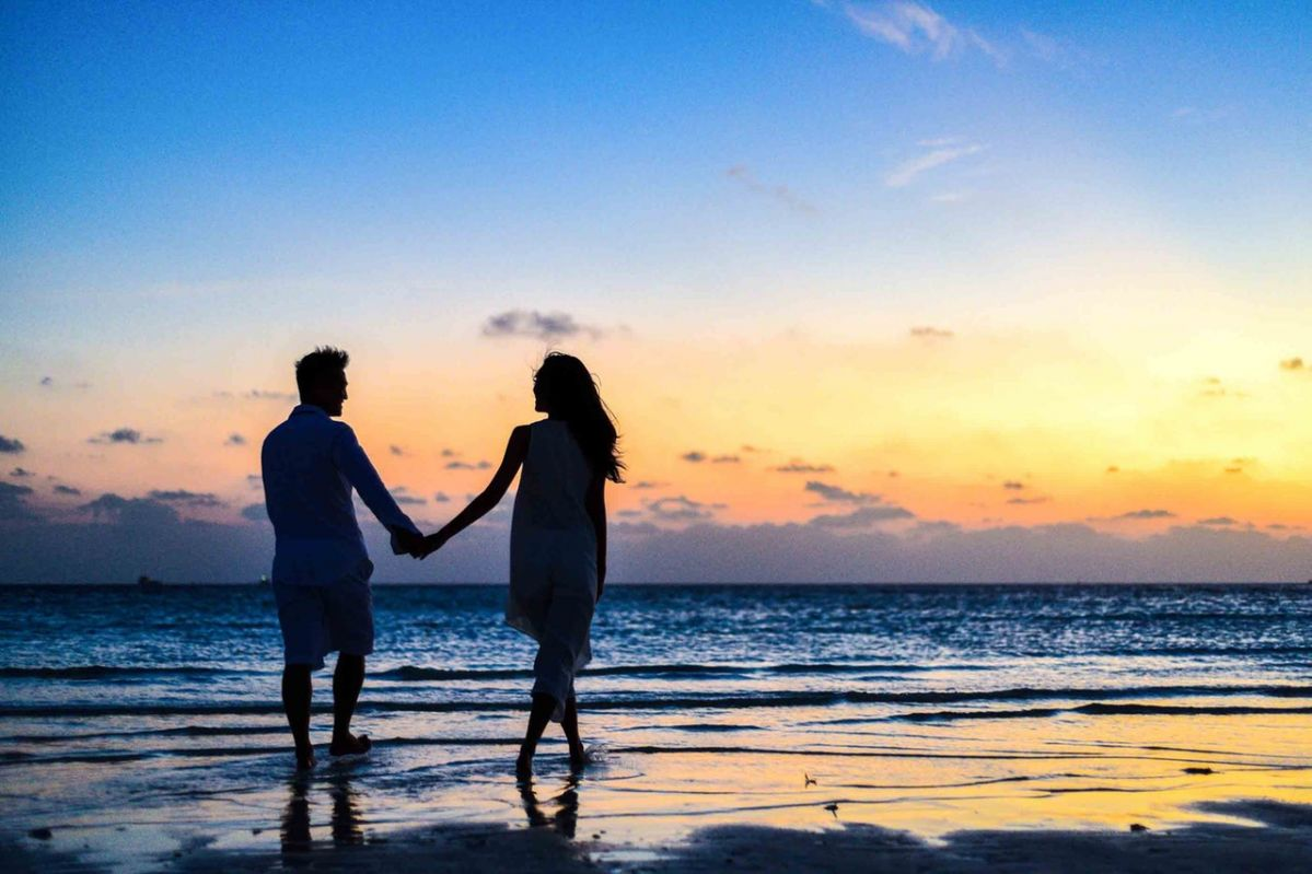 man-and-woman-holding-hands-walking-on-seashore-during-1024960-2020-02-13-10-34-large